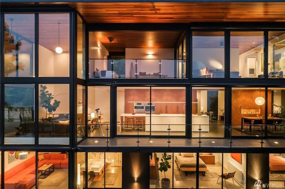 Modern luxe framed in glass comes with jaw-dropping views and a $3.185M price tag. Photo: Photos: Matthew Gallant/Clarity Via Trey Danna Coldwell Banker Bain