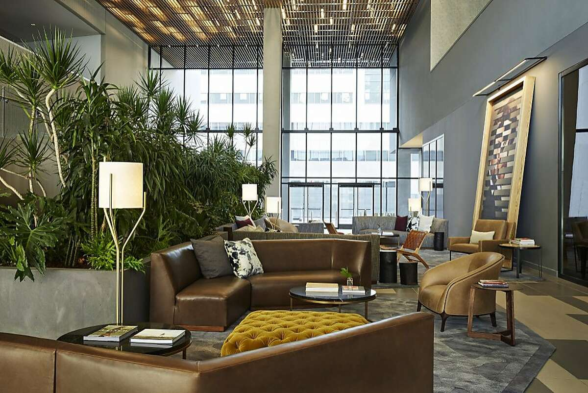 The living room area in the lobby of the Kimpton Sawyer hotel in Sacramento.
