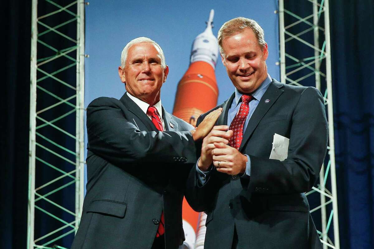Vice President Mike Pence greets NASA Administrator Jim Bridenstine before speaking to NASA's Johnson Space Center employees about the future of human space exploration at Teague Auditorium Thursday Aug. 23, 2018 in Houston.