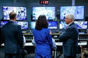 Vice President Mike Pence, right, stands with NASA Administrator Jim Bridenstine, left, and astronaut Sunita Williams, center, as he stands in the control room at NASA's Neutral Buoyancy Laboratory near Johnson Space Center as he discusses the future of human space exploration Thursday Aug. 23, 2018 in Houston.