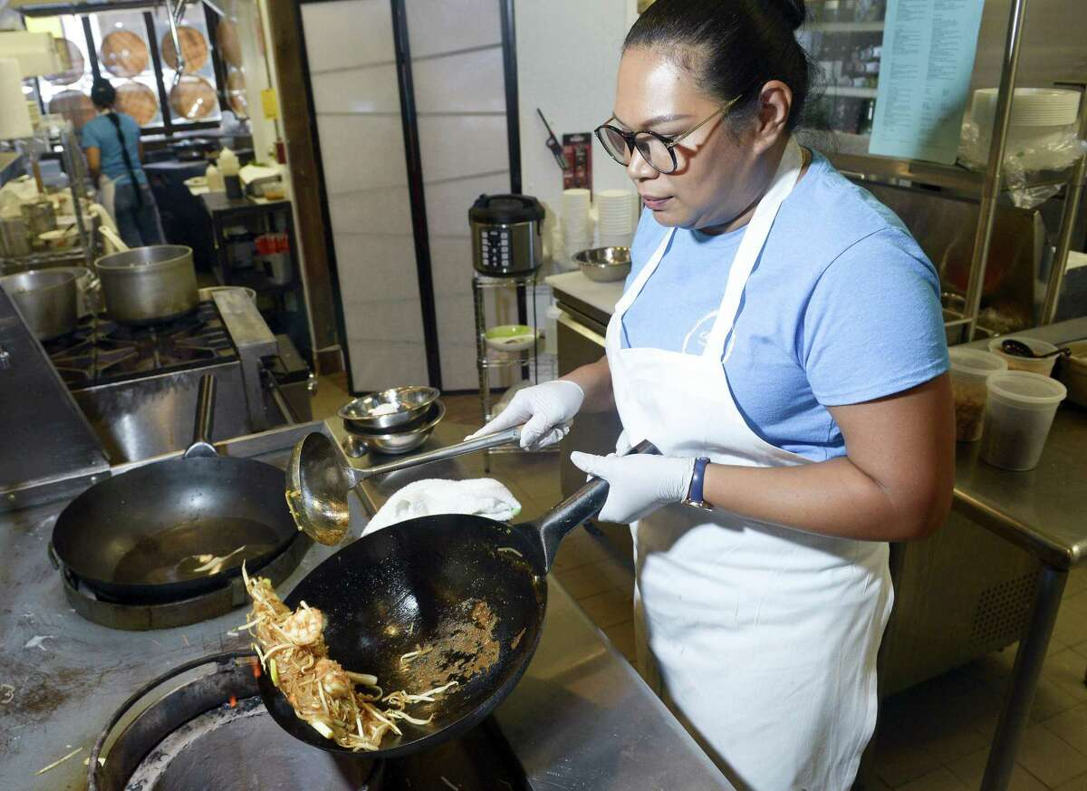 Manager and chef Apple Saengthong prepares Pad Thai shrimp at Kano Noodle Bar at 227 Summer St., in Stamford, Conn., on Thursday, Aug. 23, 2018.