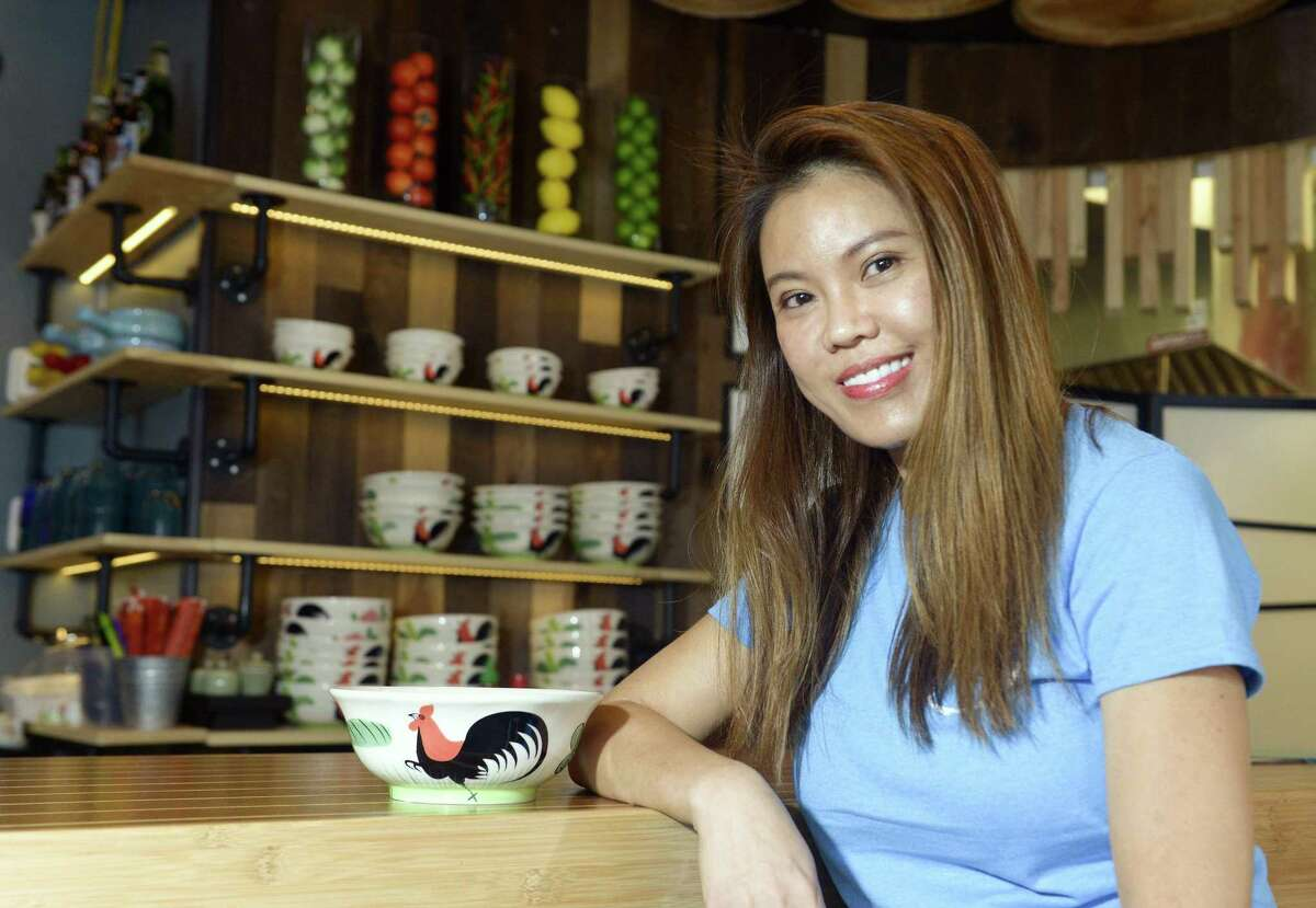 Kat Lim, owner of Kano Noodle Bar, sits at the restaurant's bar on August 23, 2018.