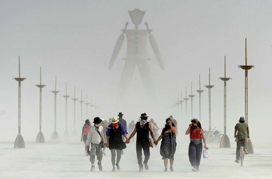 Burning Man participants walk through dust at the annual Burning Man event on the Black Rock Desert of Gerlach, Nev., on Friday, Aug. 29, 2014. Photo: Andy Barron / Reno Gazette-Journal 2014