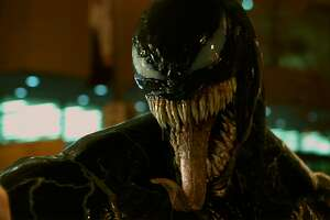 """Tom Hardy plays an investigative reporter who becomes one with an alien symbiote in the movie """"Venom"""""""