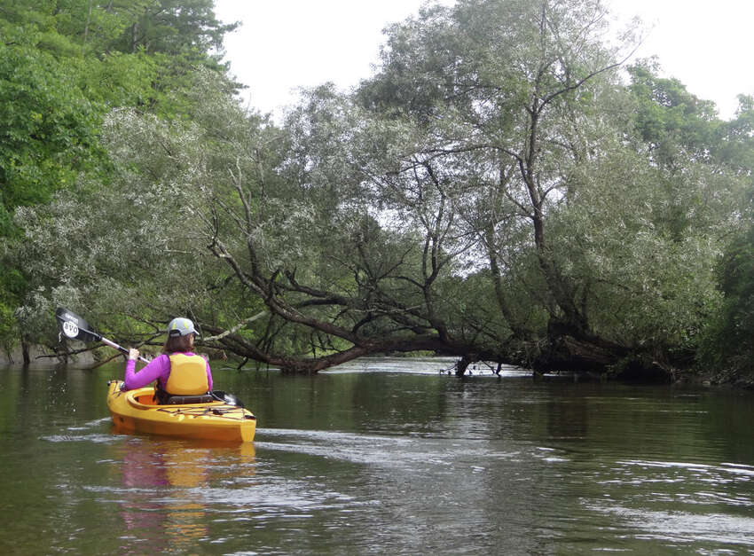 Outdoors writer Gillian Scott paddles on the Battenkill River.