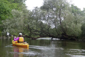 Outdoors writer Gillian Scott paddles on the Battenkill River.