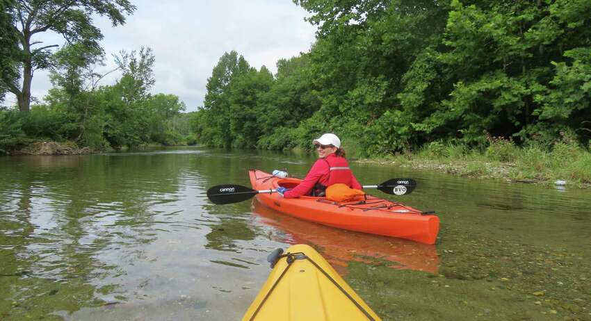Cindi Handy of Clifton Park paddles on the Battenkill River.