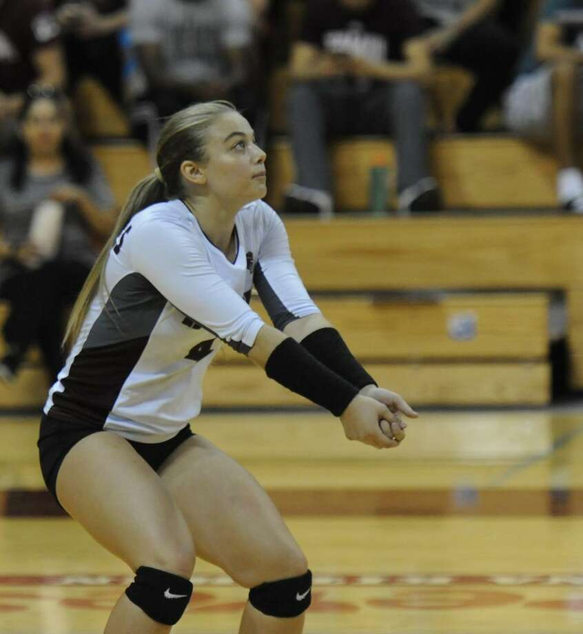 TAMIU senior libero Lacy Asdourian had a game-high 12 digs and four service aces as the Dustdevils picked up a 3-0 victory at Franklin Pierce to begin the Raven First Serve Invitational on Thursday. Photo: Courtesy Of TAMIU Athletics, File