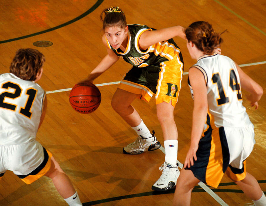 Dow High's Jillian MacDonald looks for a driving lane during a district tournament game against Cadillac in 1999. Photo: Daily News File Photo