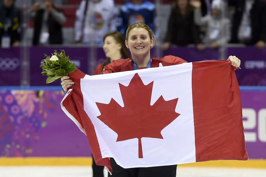 FILE - In this Feb. 21, 2014, file photo, Canada's Hayley Wickenheiser celebrates with the Canadian flag after beating the USA 3-2 in overtime at the Sochi Winter Olympics in Sochi, Russia. Wickenheiser is the Toronto Maple Leafs new assistant director of player development. (AP Photo/Paul Chiasson, The Canadian Press, File) Photo: Paul Chiasson / Associated Press