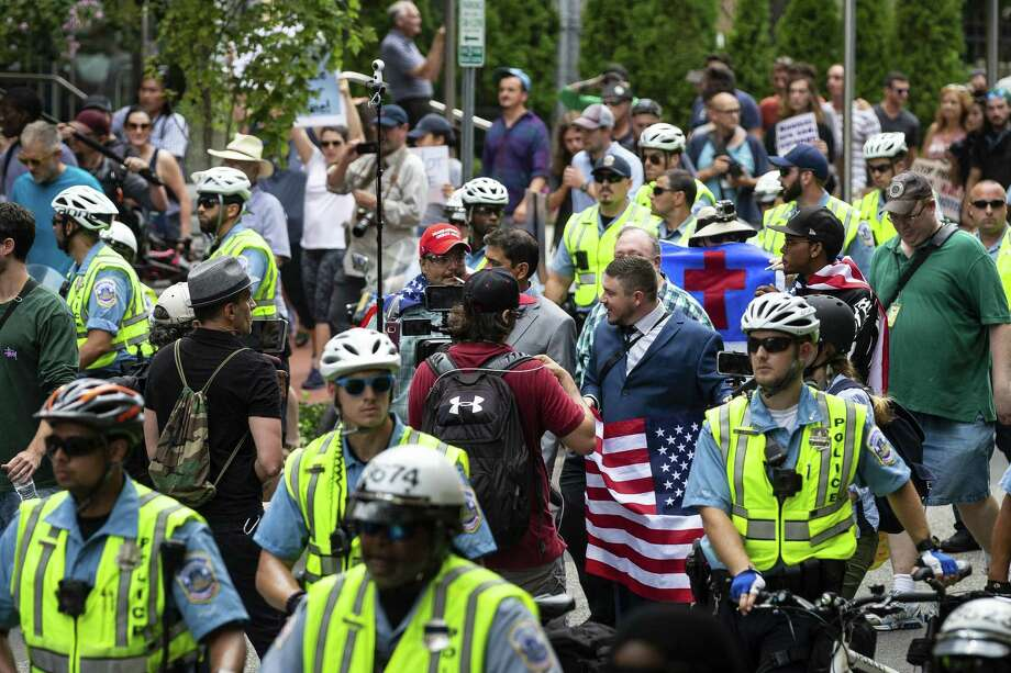 "White supremacists march toward Lafayette Square for the ""Unite the Right"" rally in Washington, Aug. 12. Are white nationalists racist? Depends who you ask. Photo: AL DRAGO /NYT / NYTNS"