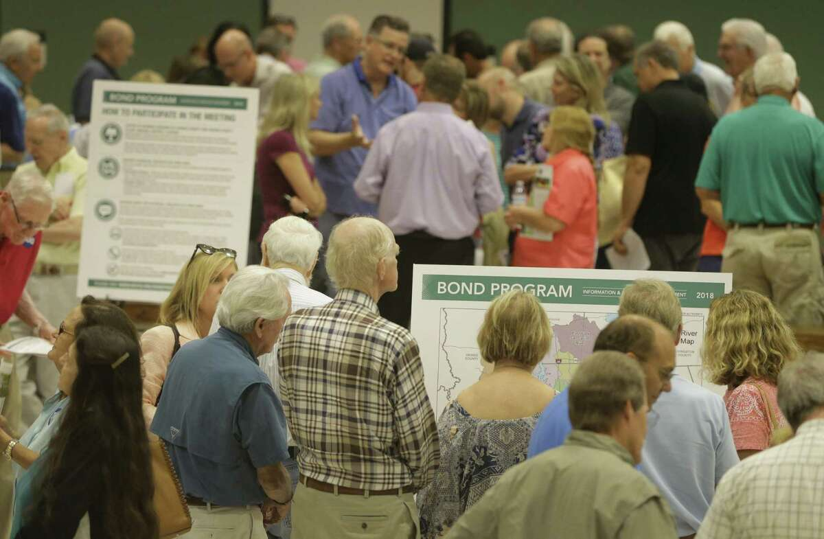 People attend the Harris County Flood Control District bond program community meeting at Kingwood Park High School, 4015 Woodland Hills Drive Kingwood, Tuesday, July 10, 2018, in Houston. ( Melissa Phillip / Houston Chronicle )
