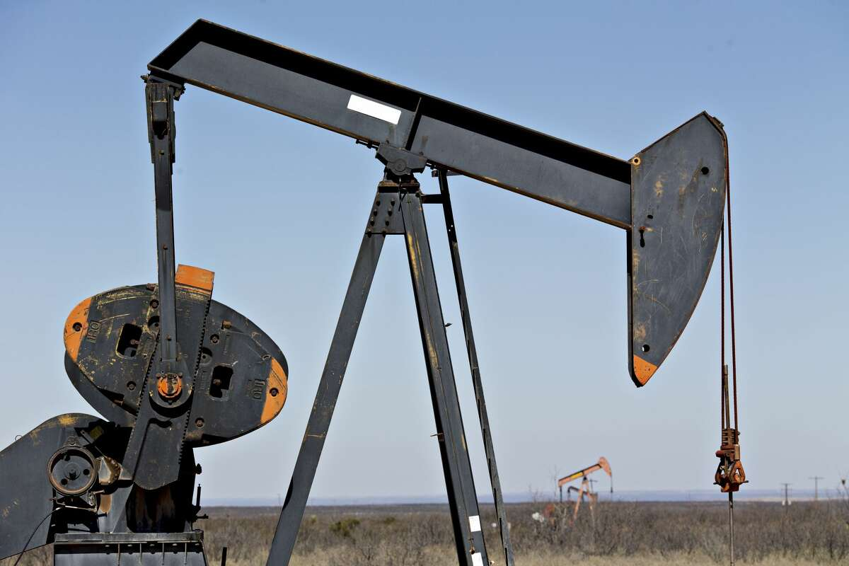 Pumpjacks operate on oil wells in the Permian Basin near Crane, Texas on March 2, 2018. MUST CREDIT: Bloomberg photo by Daniel Acker