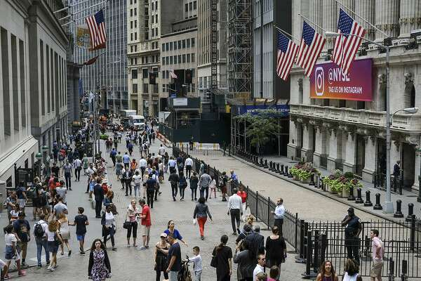 NEW YORK, NY - AUGUST 22: People walk past the New York Stock Exchange (NYSE), August 22, 2018 in New York City. Today marks the longest bull market rally in U.S. history, stretching back to March 2009. The longest previous market rally was from 1990 to March 2000. (Photo by Drew Angerer/Getty Images)