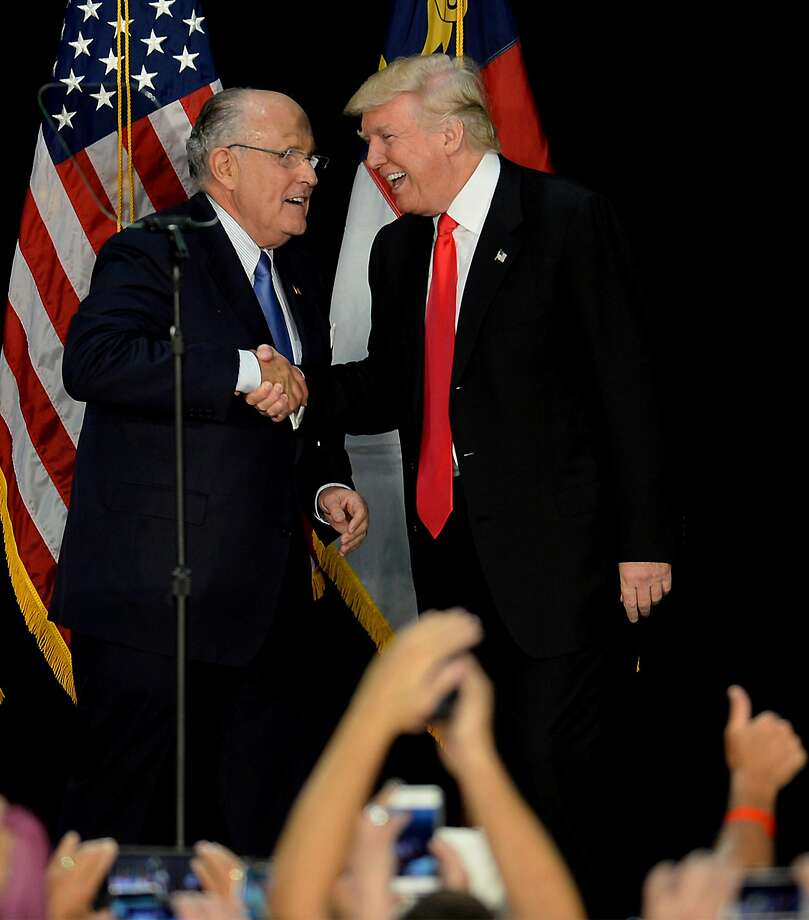 Former New York City mayor Rudy Giuliani, left, welcomes Republican presidential candidate Donald Trump on stage during a campaign rally on Aug. 18, 2016, at the Charlotte Convention Center in Charlotte, N.C. Photo: Jeff Siner, TNS