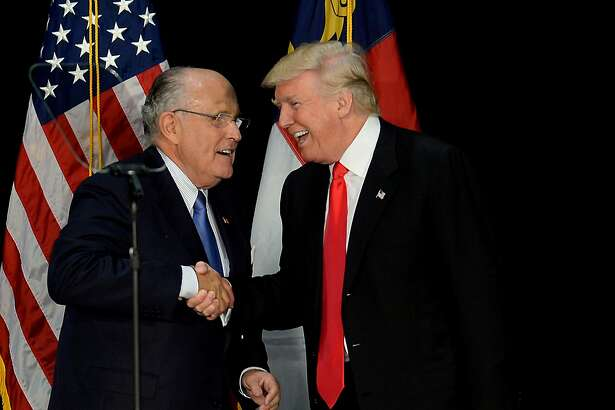 Former New York City mayor Rudy Giuliani, left, welcomes Republican presidential candidate Donald Trump on stage during a campaign rally on Aug. 18, 2016, at the Charlotte Convention Center in Charlotte, N.C. (Jeff Siner/Charlotte Observer/TNS)