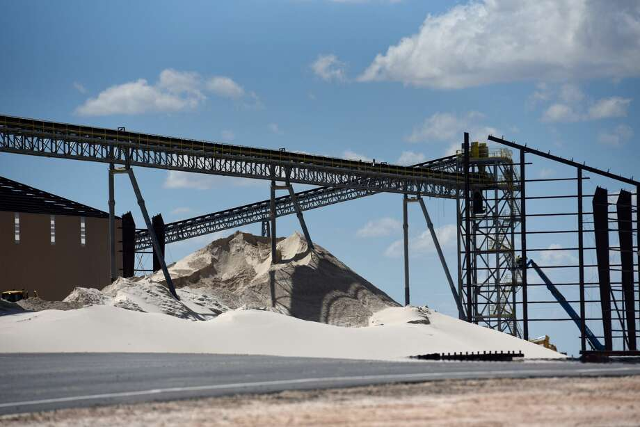 Conveyors stand above a sand pile at the Black Mountain Sand LLC Vest Mine in Winkler County, Texas, U.S., on Tuesday, June 19, 2018. In the West Texas plains, frack-sand mines suddenly seem to be popping up everywhere. Twelve months ago, none of them existed - together, these mines will ship some 22 million tons of sand this year to shale drillers in the Permian Basin, the hottest oil patch on Earth. Photographer: Callaghan O'Hare/Bloomberg Photo: Callaghan O'Hare/Bloomberg