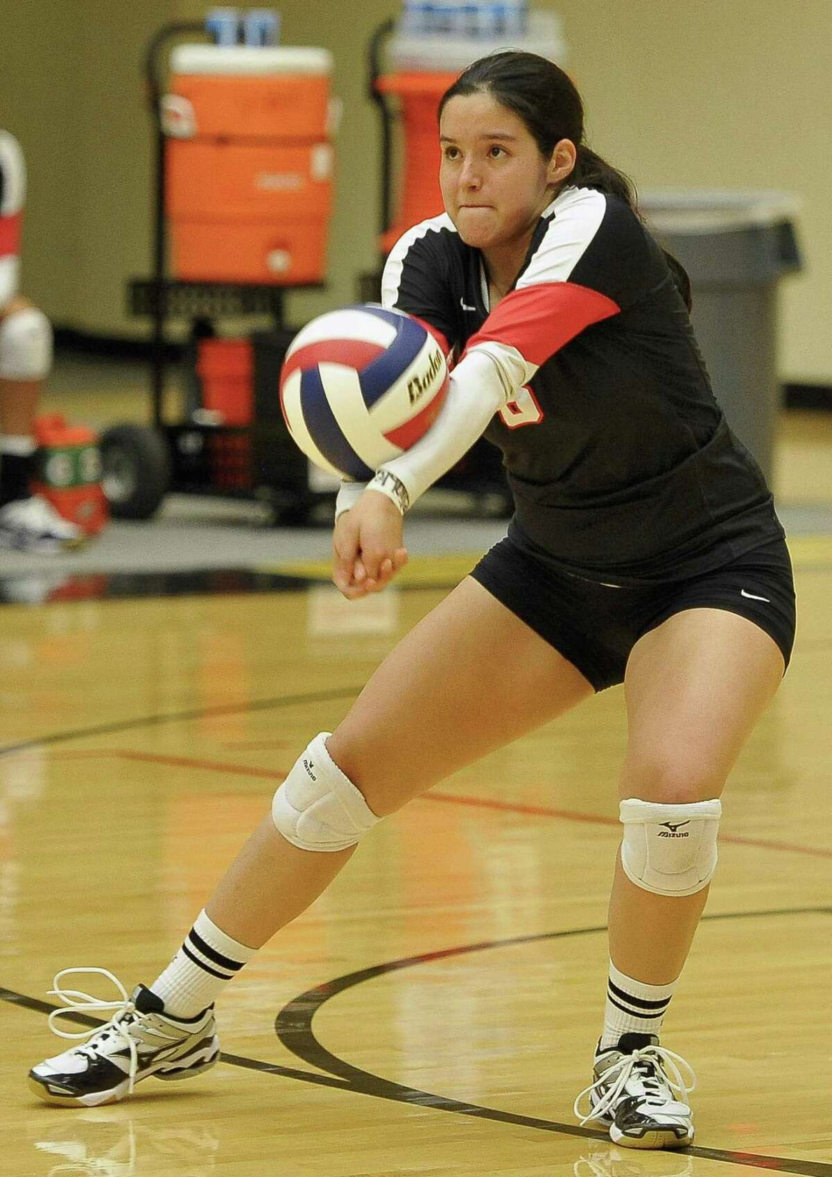 Churchill's Monica Ramon returns the ball during a high school volleyball match against O'Connor, Monday, Aug. 11, 2014, at NEISD Littleton Gymnasium in San Antonio. Churchill won 3-1. (Darren Abate/For the Express-News)