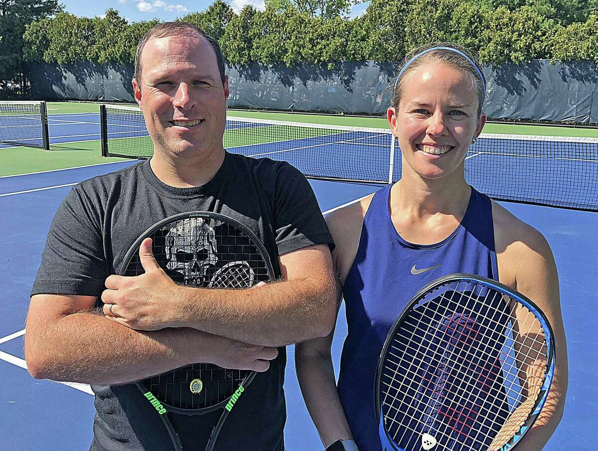 Cheshire Academy athletic director Ed Banach, left, and his wife Amy were named the Connecticut Open Family Tennis Tournament?'s Husband and Wife champions on Thursday at the Connecticut Tennis Center at Yale. Twenty six years ago, on the Yale courts, the couple first met.