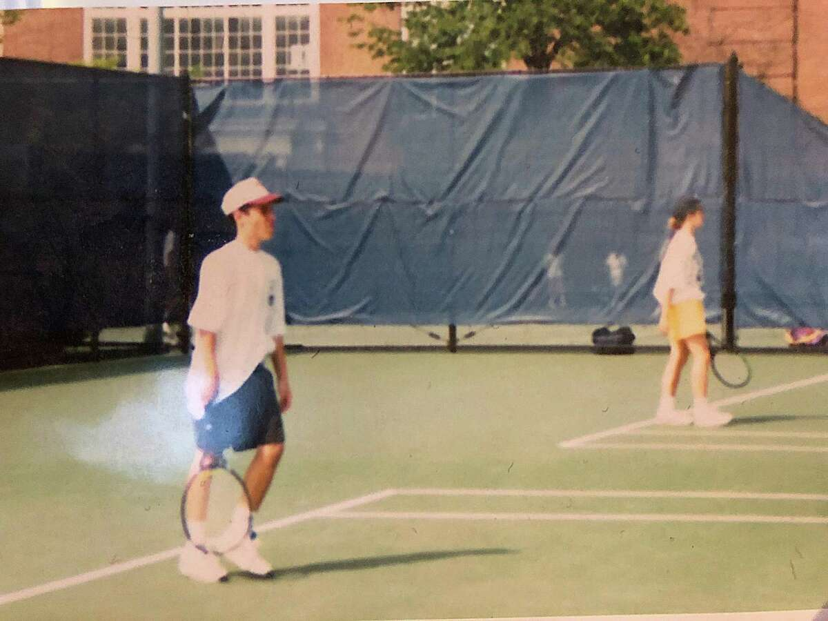 In this photo, taken 26 years ago at the Yale University tennis courts, Ed Banach, left, is playing on the court along side Amy Laraway during the Governor?'s Cup tennis tournament championships. Banach and Laraway met that day, started dating eight years later and have been married for 16 years. The two returned to Yale on Thursday to win the Connecticut Open?'s Family Tennis Tournament?'s husband-wife championship.