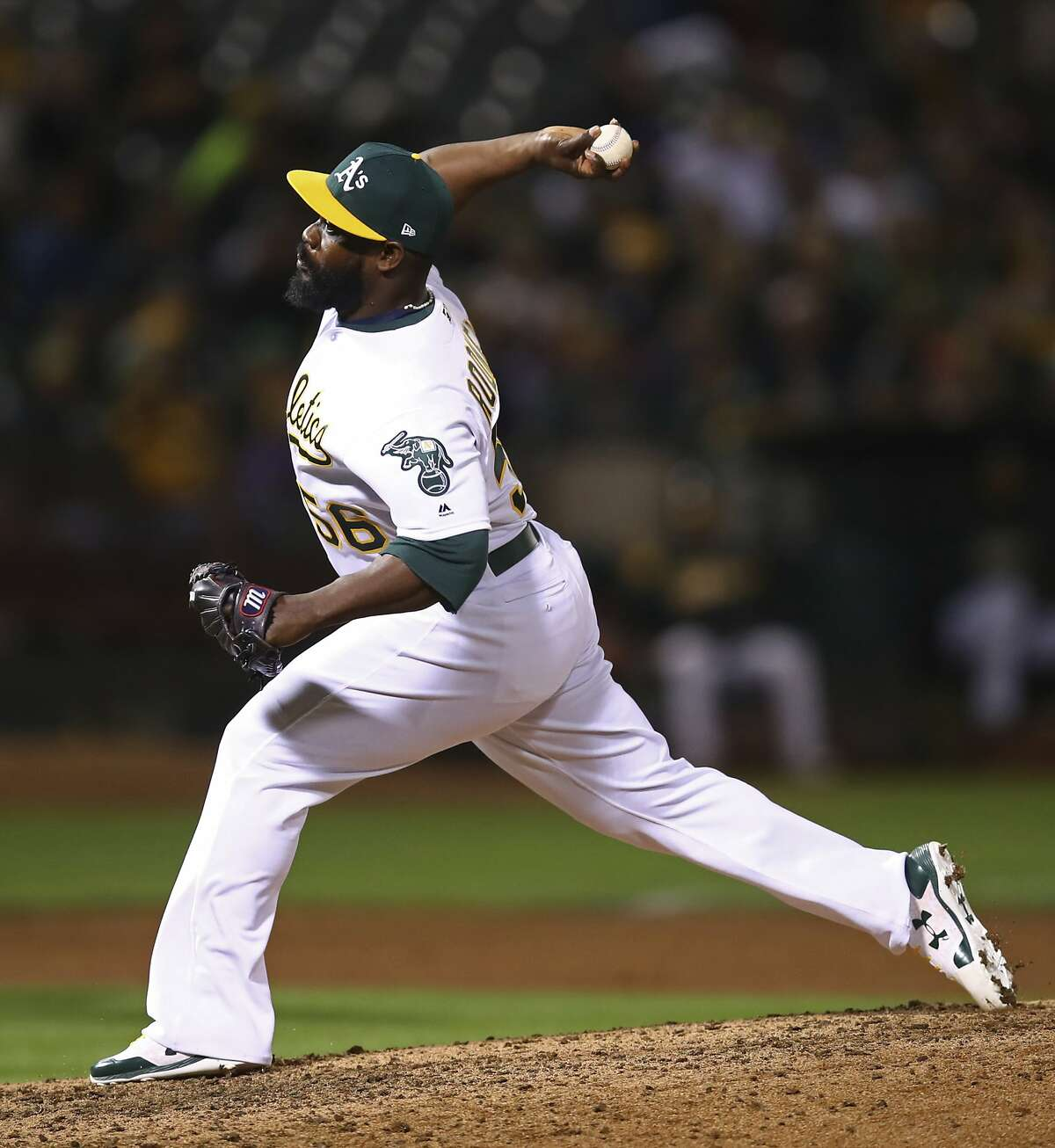 Oakland Athletics' Fernando Rodney works against the Seattle Mariners in the eighth inning of a baseball game Tuesday, Aug. 14, 2018, in Oakland, Calif. (AP Photo/Ben Margot)