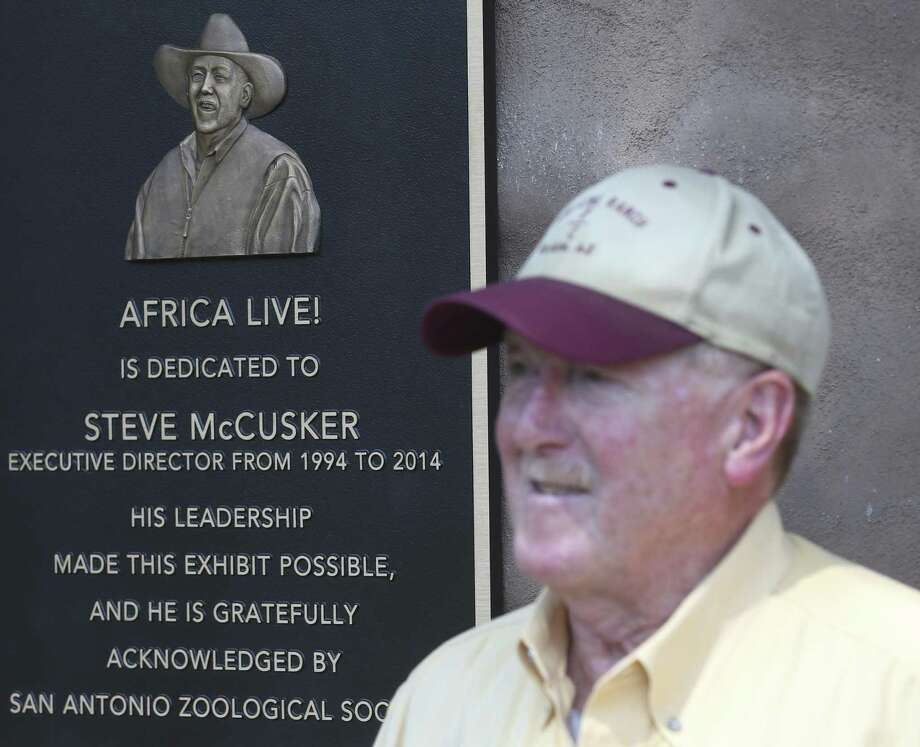 Steve McCusker stands next to a plaque Thursday, Aug. 23, 2018 dedicating the Africa Live! exhibit at the San Antonio Zoo to him. McCusker was the executive directer of the zoo for 20 years and was behind the push to build the exhibit. Photo: William Luther, Staff Photographer / San Antonio Express-News / © 2018 San Antonio Express-News