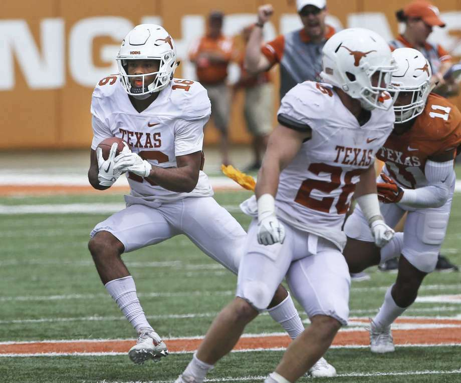 AUSTIN, TX - APRIL 21: Texas Longhorns WR Jerrod Heard (left) is tackled by Jarmarquis Durst (28) during the orange and white spring game on April 21, 2018 at Darrell K Royal-Texas Memorial Stadium in Austin, TX. Photo: (Photo By John Rivera/Icon Sportswire Via Getty Images)