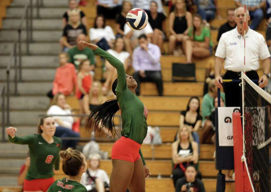 The Woodlands' Amanda Ifeanyi goes for a kill during a varsity volleyball match against Oak Ridge at The Woodlands High School on Tuesday. Photo: Michael Wyke / Contributor / © 2018 Houston Chronicle
