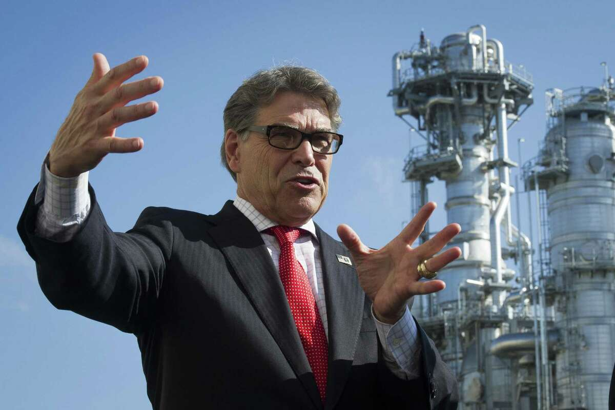 Secretary of Energy Rick Perry stands with the main cyrogenic heat exchange behind him as he speaks with reporters at Dominion Energy's Cove Point LNG liquefaction Project facility in Lusby, Md., Thursday, July 26, 2018. The completion of the facilities export expansion project makes it just the second LNG export facility in the U.S.