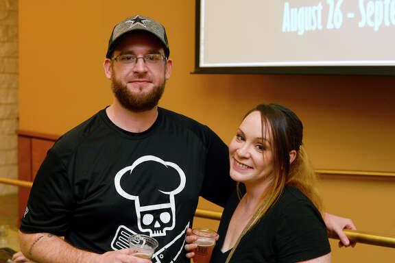 Marcus Bruner and Ashley Harris during the #EatBMT restaurant week preview tasting at Del Papa Distributing. Photo taken Thursday 8/23/18 Ryan Pelham/The Enterprise