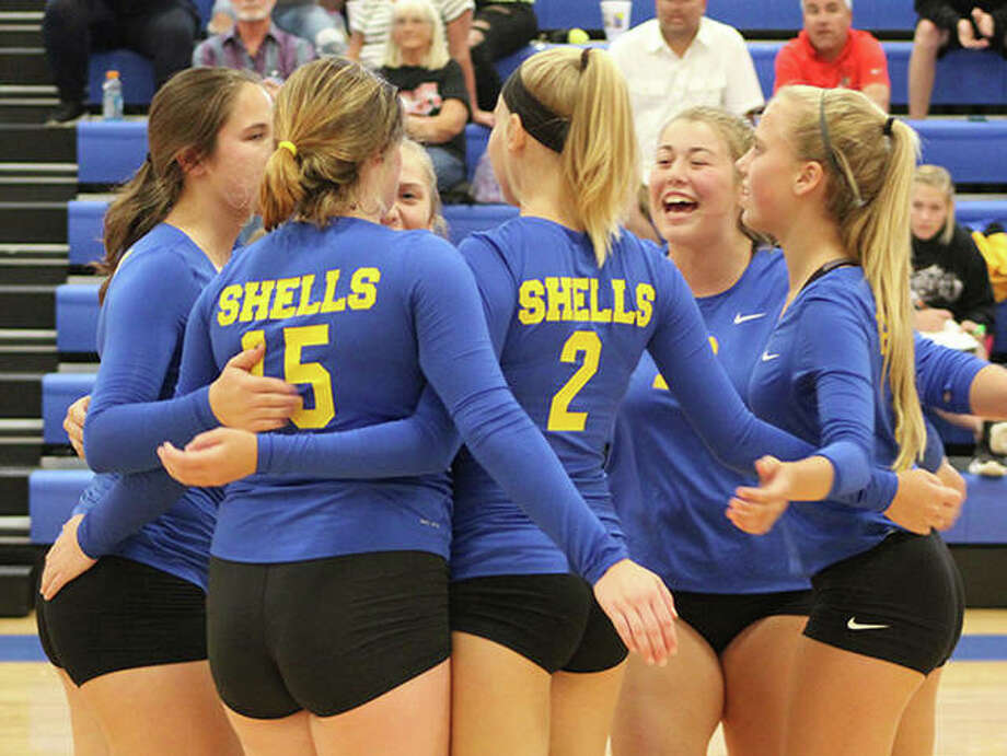 Roxana players celebrate a point late in the Shells' victory over Calhoun on Monday at the Roxana Tourney. Photo: Greg Shashack / The Telegraph