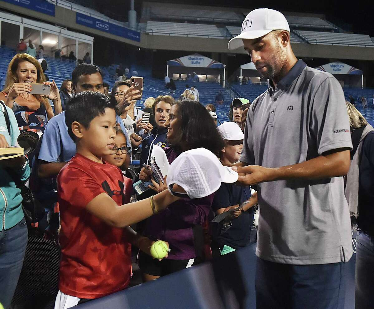 USA's James Blake signs autographs following his win over Germany's Tommy Haas on Stadium Court Thursday, August 23, 2018, in the Invesco series QQQ Men's Legends at the Connecticut Open at the Connecticut Tennis Center at Yale in New Haven. Blake, 6-4.