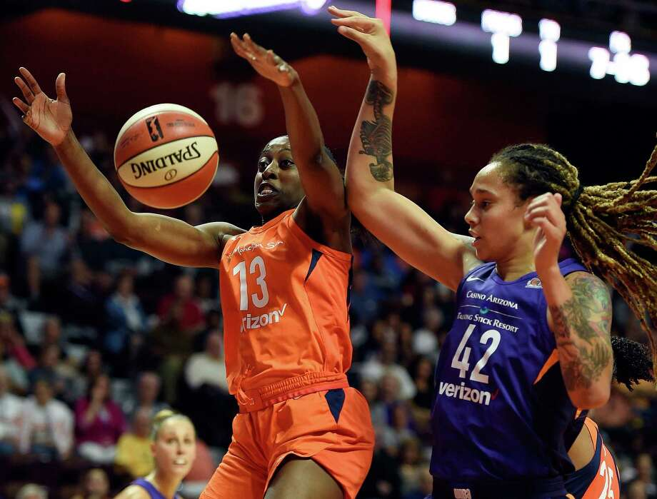 Connecticut Sun forward and Cy-Fair product Chiney Ogwumike loses the handle on the ball as she is defended by Phoenix Mercury center Brittney Griner (42) during the first half of a single-elimination WNBA basketball playoff game Thursday, Aug. 23, 2018, in Uncasville, Conn. (Sean D. Elliot/The Day via AP) Photo: SEAN D. ELLIOT, Associated Press / 2018 The Day Publishing Company