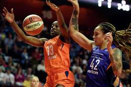Connecticut Sun forward Chiney Ogwumike loses the handle on the ball as she is defended by Phoenix Mercury center Brittney Griner (42) during the first half of a single-elimination WNBA basketball playoff game Thursday, Aug. 23, 2018, in Uncasville, Conn. (Sean D. Elliot/The Day via AP)