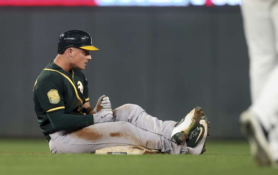 Oakland Athletics' Matt Chapman sits on second base after doubling off Minnesota Twins pitcher Kohl Stewart in the fifth inning of a baseball game Thursday, Aug. 23, 2018, in Minneapolis. (AP Photo/Jim Mone) Photo: Jim Mone / Associated Press