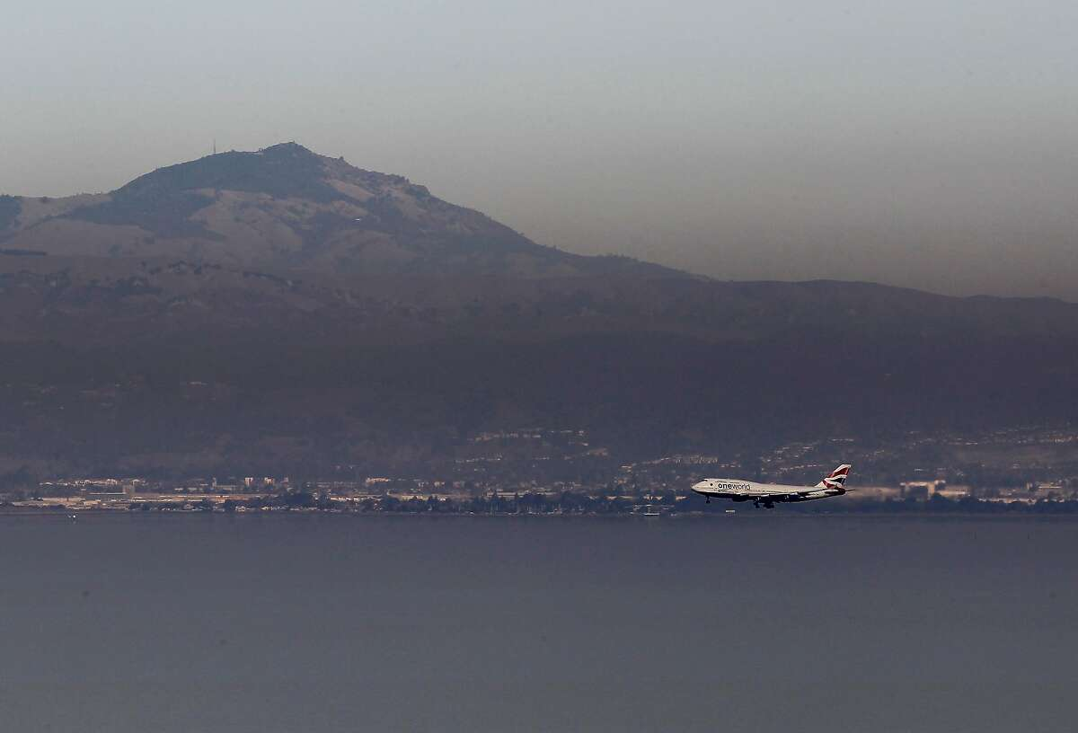 A plane approaches SFO from the south past Mount Diablo which is partially obscured by smog Wednesday January 4, 2011. Spare the Air days are becoming commonplace in the Bay Area with so little rain or wind in the forecast, making it difficult to have a wood fire this winter.
