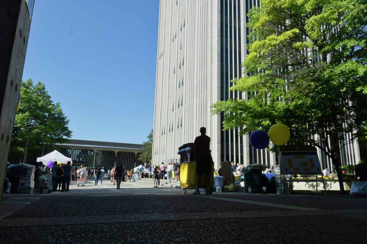 Incoming students and family members wait in line to use the elevators in the Indian Quad tower during UAlbany freshman move-in day on Thursday, Aug. 23, 2018, in Albany, N.Y. The school is welcoming 2,750 freshmen this year. (Paul Buckowski/Times Union)