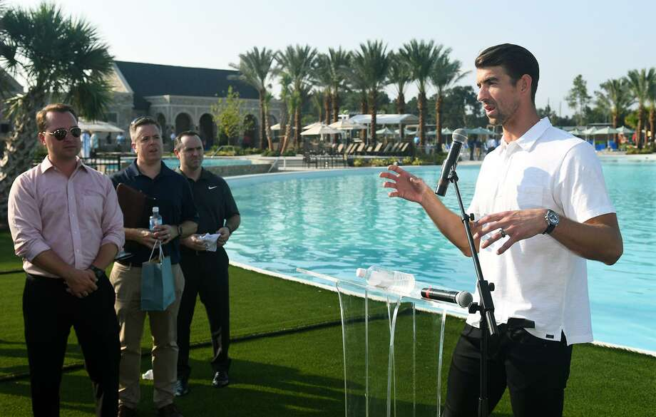 PHOTOS: First look at the completed Crystal Lagoon23-time Olympic gold medalist swimmer Michael Phelps, right, addresses the media during the grand opening of the Crystal Lagoon in the Balmoral community in Humble on August 23, 2018.>>>Take a look around the completed 1-acre water feature... Photo: Jerry Baker, Houston Chronicle / Contributor / Houston Chronicle