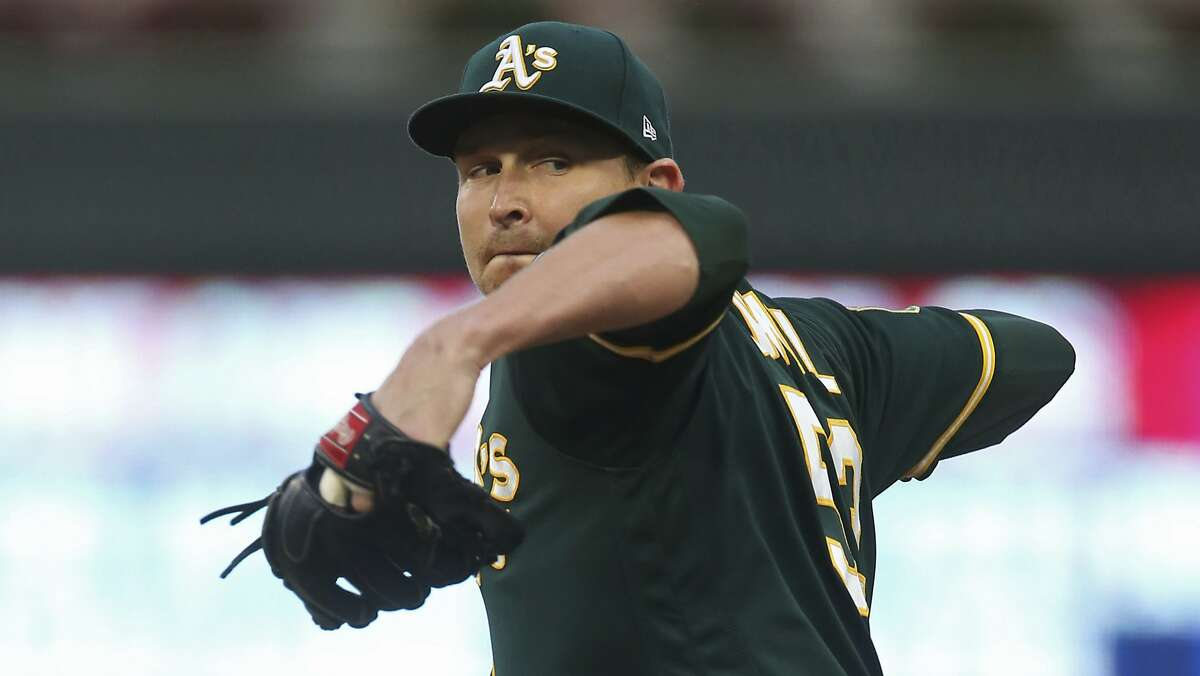 Oakland Athletics pitcher Trevor Cahill throws against the Minnesota Twins in the first inning of a baseball game Thursday, Aug. 23, 2018, in Minneapolis. (AP Photo/Jim Mone)
