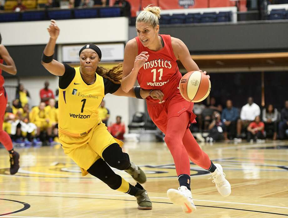 Mystics guard Elena Delle Donne drives to the basket against Sparks guard Odyssey Sims. Photo: Nick Wass / Associated Press