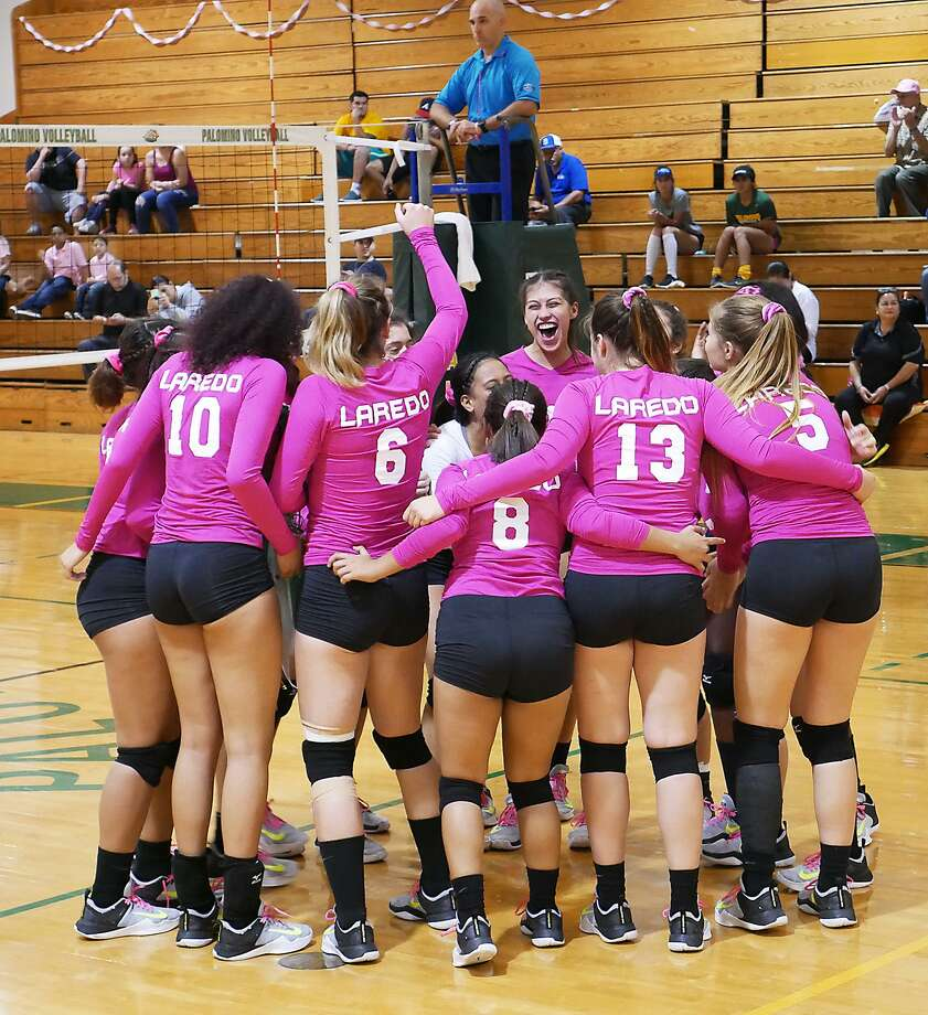The Laredo College volleyball team celebrates during the DigPink breast cancer awareness game last October. The Palominos begin the 2018 season on Friday with a pair of games in the Vernon College Classic. Photo: Cuate Santos / Laredo Morning Times File / Laredo Morning Times