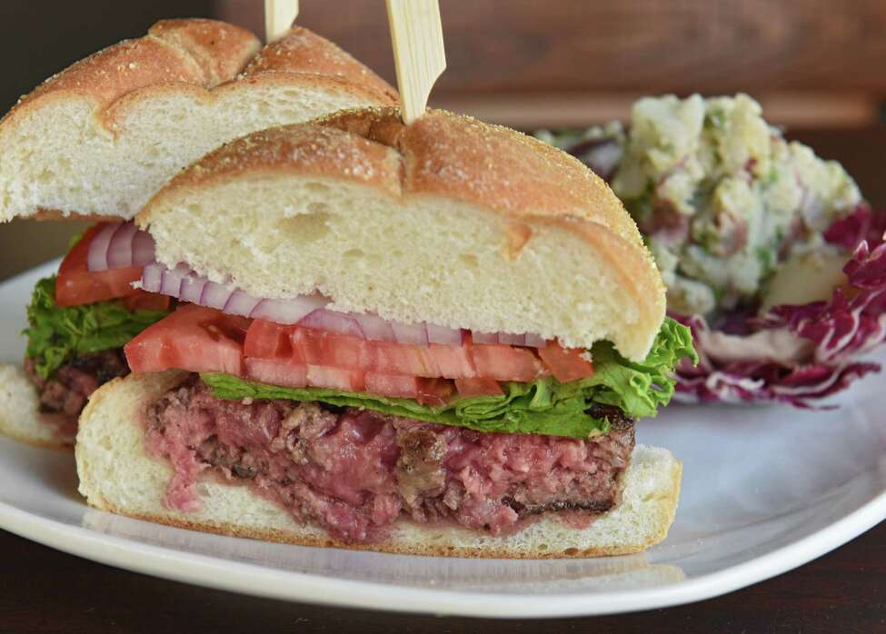 Bourbon room burger at Downtown Social on Thursday, Aug. 16, 2018 in Glens Falls, N.Y. 8-ounce signature blend ground beef, pork, and veal charbroiled to you liking. Served with a house pickle spear, lettuce, tomato, onion, and your choice of house veggie chips, German potato salad, or house slaw. (Lori Van Buren/Times Union)