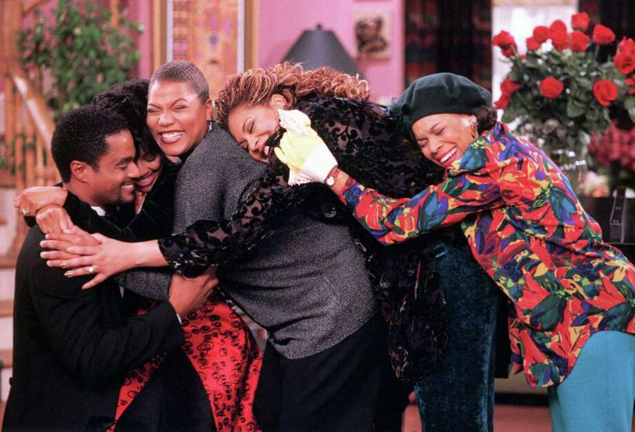 "119712 LIVING SINGLE: Regine (Kim Fields Freeman, second from L) accepts Dexter Knight's (Donald Franklin, L) marriage proposal while her roommates, Khadijah (Queen Latifah, C) and Synclaire (Kim Coles, second from R), and her mother (Chip Hurd, R) share in a group hug in the LIVING SINGLE episode ""Three Men and a Buckeye"" Thursday, Nov. 13 (8:00-8:30 PM ET/PT) on FOX.  FOX BROADCASTING COMPANY CR: RON TOM Photo: RON TOM, FOX / FOX"