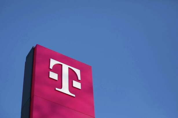 The T-Mobile logo stands outside the Deutsche Telekom AG headquarters in Bonn, Germany, on Feb. 22, 2018.