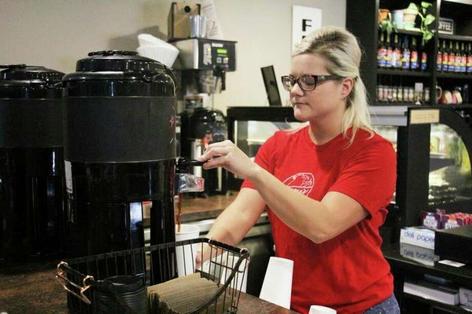 Emma's barista Casey Ney pours a fresh, hot cup of coffee during an early shift one morning. The 28-year-old is an expert at making the 20-plus unique drinks that the coffee house offers. (Bradley Massman/Huron Daily Tribune)