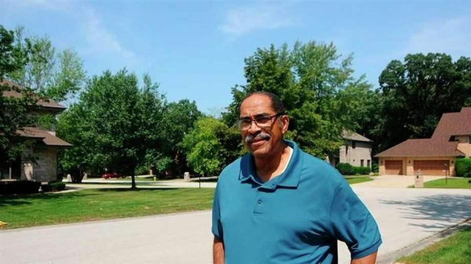 Sterling Burke, president of the board of trustees of Olympia Fields, Ill., near his home. The village has the highest black homeownership rate in the country among majority-black cities. (The Pew Charitable Trusts/TNS)