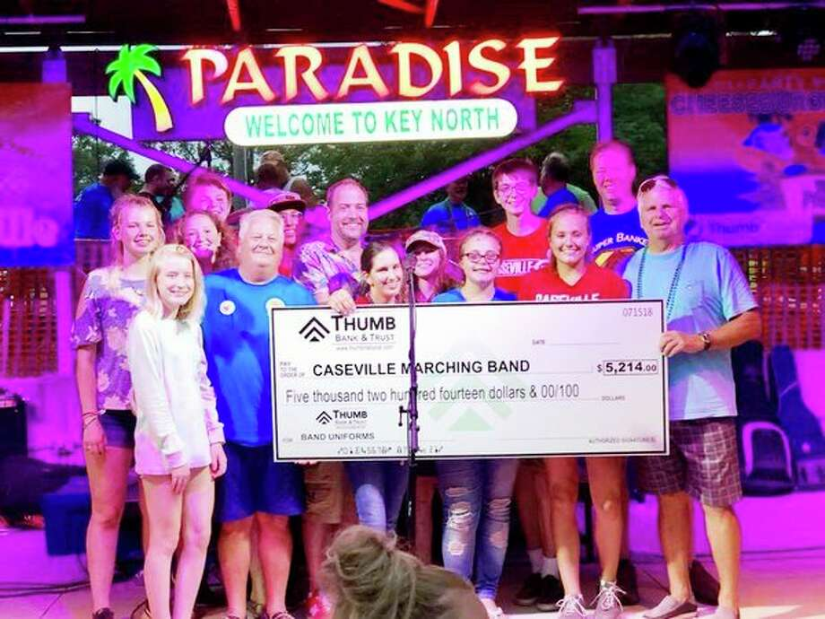 Thumb Bank & Trust recently presented a check for more than $5,000 to the Caseville High School Marching Band for new uniforms. All of the money was raised from the bank's Key North Classic golf tournament. (Submitted Photo)