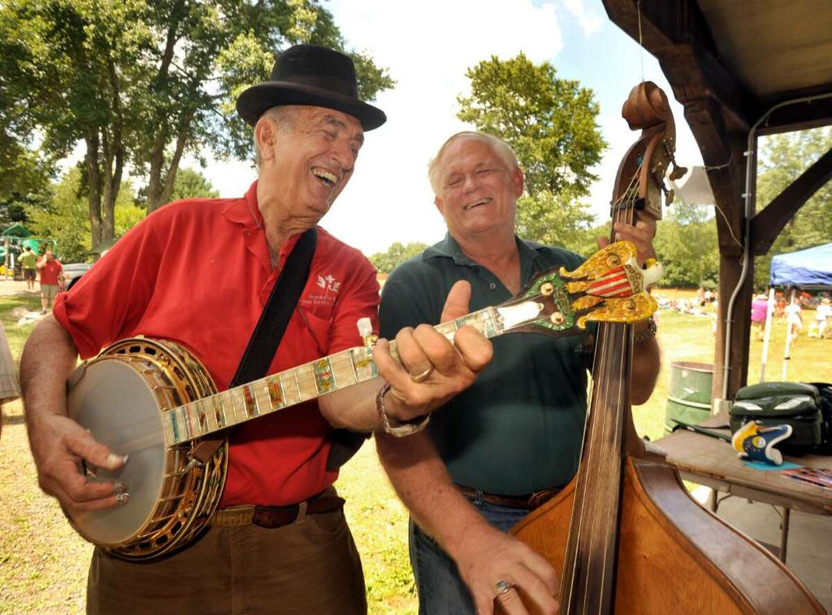 Legendary banjo player Roger Sprung, 80, left, of Newtown, jams with Richard Hawthorne of Wingdale, N.Y., during Pickin and Fiddlin, in Roxbury, on Sunday, July 11, 2010.