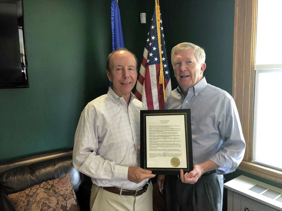 Paul Reinhardt, left, founder of New Canaan Parent Support Group, and First Selectman Kevin Moynihan hold a proclamation of Overdose Awareness Day. Moynihan has declared Aug. 30 as Overdose Awareness Day and urges New Canaan citizens to join him at the second annual Overdose Awareness Vigil at 7 p.m. at 6 South Ave. Rain date is Aug. 31. Photo: /