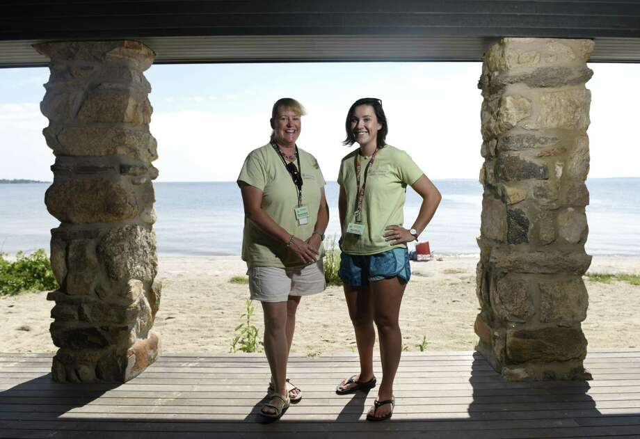 Seaside Center naturalists Marianna Perrier, left, and Alex Purcell pose at Greenwich Point Park's Seaside Center in Old Greenwich, Conn. Thursday, Aug.9, 2018. The naturalists run the Seaside Center operation over the summer by leading talks, scavenger hunts, crafts, salt marsh walks, and managing a staff of interns. Photo: Tyler Sizemore / Hearst Connecticut Media / Greenwich Time